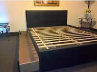 King size black leather bed with larger storage drawer (Free delivery see description)