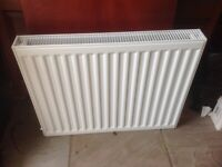 Unused double radiator with brackets 900 lengthx700height(cms)