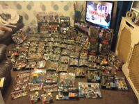 Fantastic WWE and Wrestle mania collection from figures,books,DVDs,lot lot more