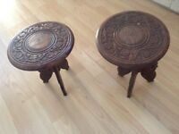 Two carved stools/table