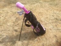 Golf set by Golf Girl Junior Tour. Set of 5 clubs with bag in pink and black. Good used condition.