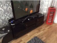 T.V. Unit for TVs up to 60ins black piano finish