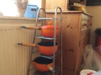 Set of three orange cast iron pans with lids . Excellent condition