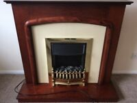 Dark wood electric fire and surround