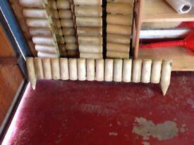Lawn edging log panels