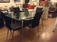 Glass table with 4 chairs £25