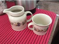 WANTED 8 Royal Doltan saucers to match cup and milk jug in picture