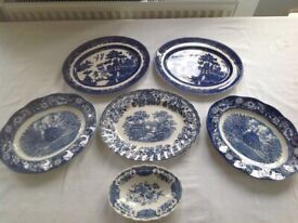 Six oval blue and white dishes (possibly collectible).