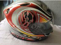 Large motorcycle coat and nitro helmet