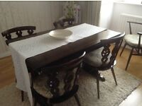 dark wood Ercol vintage dining table and six chairs