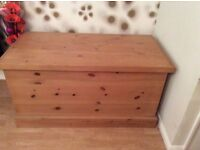 A large pine storage chest