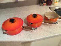 Set of three Le Creuset pans, two with lids. Have been used but in good condition.