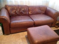 Leather sofa with square pouf . Brown soft leather in good condition.