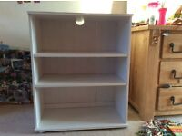 White wood IKEA bookcase perfect for bedroom.
