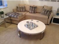 Beige sofa bed with storage.