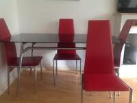 Black Glass Table with faux Red leather chairs x 5