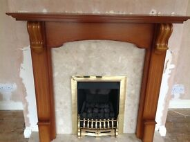 Gas coal effect fire with marble hearth and back with wooden surround