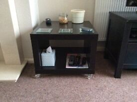 Ikea Black Square coffee table on castors with under shelf.