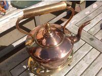 Copper kettle and brass trivet