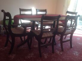 Dark wood oblong table set with 6 chairs