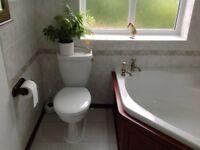 White Bathroom Suite with Corner Bath
