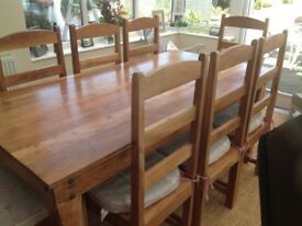 Solid wood dining table with 8 chairs