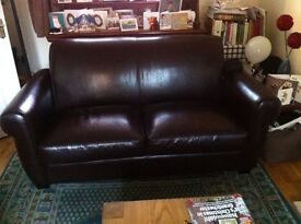 Dark brown faux leather sofa & armchair