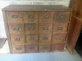 Victorian teak set of drawers with brass handles.