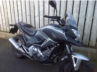 Honda nc 700 xa-c in very good contion and riding like new with only 10 thu miles