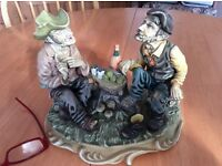 Capidamonte style figure. Two old men having a bite to eat.