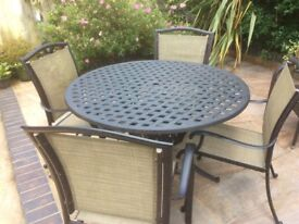 Alexander Rose round table and 4 chairs excellent condition. Cost £1200 new hardly used