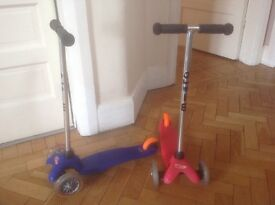 2 x mini micro scooters - one blue, one pink