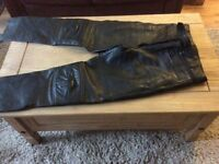 Rayven black leather ladies size 10 motorcycle trousers.