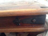 Large dark wood coffee table with metal Finnish on corners