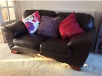 Brown leather two seater sofa, good condition.
