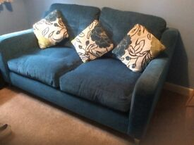 Blue 2 seater sofa with 3 reversible cushions