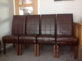 4 dark brown leather dining room chairs