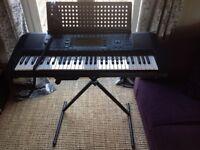 Yamaha electric keyboard, stand and headphones
