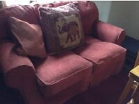 Two seater sofa in very good condition, cushions included. Dark rusty red, much darker than photo.