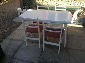 White melamine kitchen table and four upholstered chairs. Good condition.