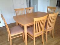 Light oak dining table and 6 chairs in excellent condition. MUST SEE