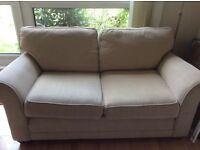 Medium 2 seater beige sofa
