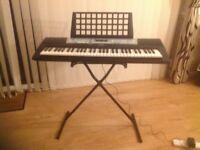 Portable Yamaha keyboard for sale.