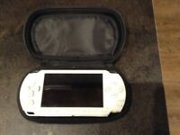 White PSP console and games.