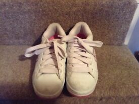 Pink and white heelys,