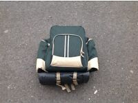 Green picnic rucksack complete with blanket and settings for four