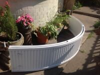 Curved double radiator for bay window