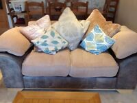 Two identical two seater sofas