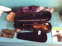 Full sized violin with book rosin tuner and shoulder rest