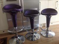 Three purple Gas Bar Stools, adjustable height